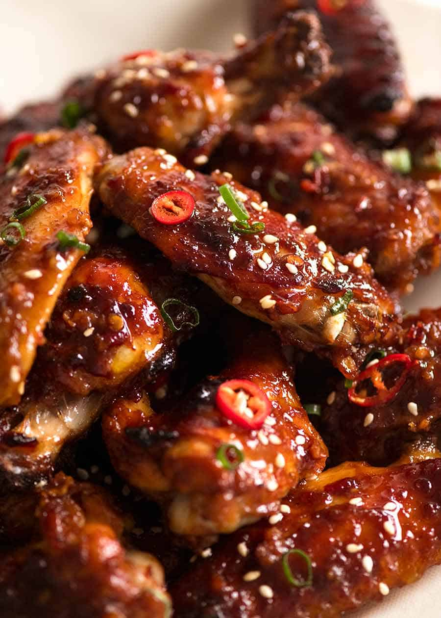 Close up of sticky baked wings (Chinese flavour), ready to be eaten