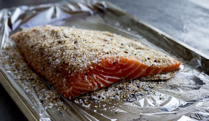 raw salmon coated with salt and spice mixture